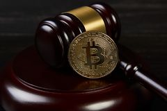 Gavel and bitcoins on a wooden desk. Dark background, Auction gavel and bitcoin symbol on black table, close-up. Bitcoin Currency Technology Business Internet stock photos