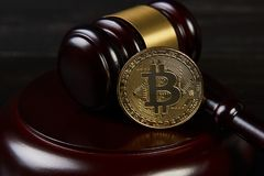 Gavel and bitcoins on a wooden desk. Dark background, Auction gavel and bitcoin symbol on black table, close-up. Bitcoin Currency Technology Business Internet stock images