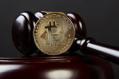 Gavel and bitcoins on a wooden desk. Dark background, Auction gavel and bitcoin symbol on black table, close-up. Bitcoin Currency Technology Business Internet stock image