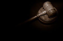 Gavel on black. Judge's legal gavel on a law book Royalty Free Stock Photo