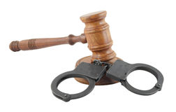 Gavel and black handcuffs Stock Photography