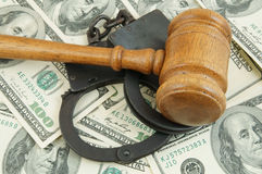 Gavel and handcuffs on money background Royalty Free Stock Photo