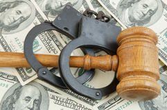 Gavel and handcuffs on money background Stock Photography
