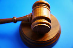 Gavel on blue. Wooden judge's gavel on blue background Stock Photography
