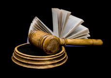Gavel and book on a black background closeup. Gavel and open book isolated on a black background closeup Royalty Free Stock Photography