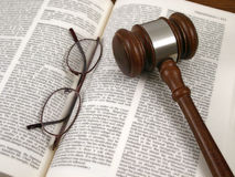 Gavel on Book (Close Up). Law book with glasses and gavel stock images