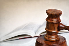 Gavel with Book and Copy Space. Wooden gavel with blurred law book behind.  Lots of copy-space Royalty Free Stock Photography