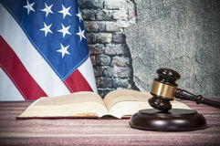 Gavel , book and USA flag. Gavel open book on background of US flag Stock Images