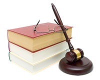 Gavel, books and glasses closeup isolated on white background Stock Image