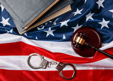Gavel, books and handcuffs Stock Photos
