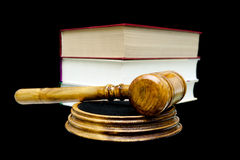 Gavel and books isolated on a black background close-up Royalty Free Stock Images