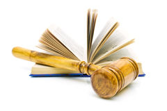 Gavel and books on white background. Gavel and open book  on white background Royalty Free Stock Photography