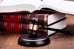 Gavel With Books On Wooden Desk Stock Photography