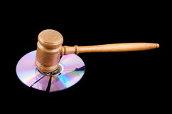 Gavel on broken disk isolated Stock Image
