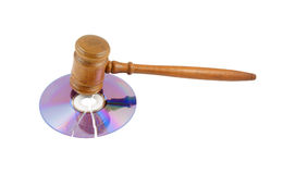 Gavel on broken disk isolated Royalty Free Stock Photos