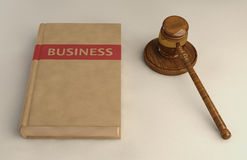 Gavel and Business law book on linen surface Royalty Free Stock Photos