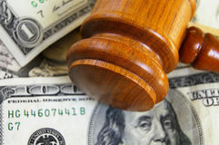Gavel on cash. Closeup of a gavel on cash, from above Royalty Free Stock Photos