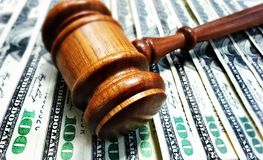 Gavel and cash money. A court gavel on 100 bills - legal concept Royalty Free Stock Photography