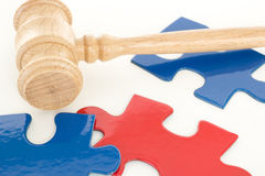 Gavel with colorful puzzle pieces. Gavel with some colorful puzzle pieces Royalty Free Stock Images