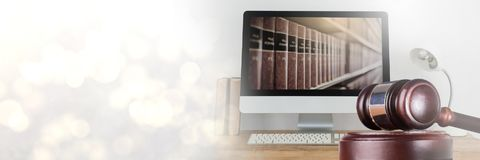 Gavel and computer with books of law and justice with transition. Digital composite of Gavel and computer with books of law and justice with transition royalty free stock images