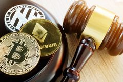 Gavel and cryptocurrency. Government regulation concept. royalty free stock photos