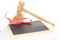 Gavel with degree and blackboard Stock Photography