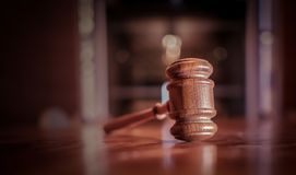 Legal law justice image. Gavel on desk top in court room with copy space royalty free stock images