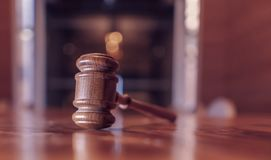 Legal law justice image. Gavel on desk top in court room with copy space stock photos