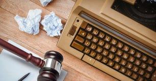 Gavel on desk with typewriter Royalty Free Stock Image