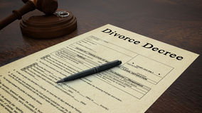 Gavel Divorce Paper Decree Right. Side low shot of a divorce decree paper with a pen, gavel and rings in the scene Royalty Free Stock Images