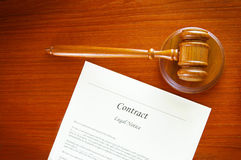 Gavel doc. Judges gavel and a contract document Royalty Free Stock Images