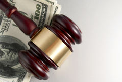 Gavel and dollars Royalty Free Stock Images