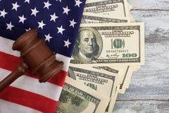 Gavel, dollars and American flag. Stock Photo