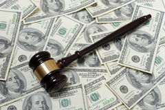 Gavel with dollars. Gavel with 100-dollars banknote Royalty Free Stock Photo