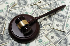 Gavel with dollars. Gavel with 100-dollars banknotes Royalty Free Stock Photography