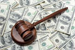 Gavel with dollars. Gavel with 100-dollars banknotes Royalty Free Stock Photos