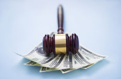 Gavel and dollars Stock Images