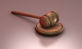 Gavel down. On stand with reflective background Stock Photos