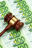 Gavel and euro notes. Gavel and euro banknotes. symbol photo for costs in court of law and auctions Royalty Free Stock Image