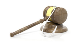 Gavel with fishing hook Stock Photos