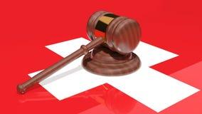 Gavel on the flag of Switzerland. Ed judges gavel on the flag of Switzerland Stock Image