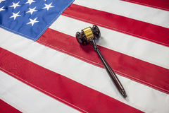 Gavel on the flag of US Stock Photography