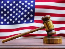Gavel in front of American Flag Stock Photos