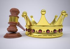 Gavel and gold crown Stock Images