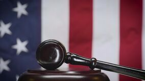 Wooden Gavel Strikes the Sounding Block Twice in American Courtroom