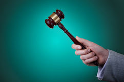 Gavel in the hand Royalty Free Stock Photography