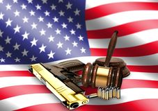 Gavel and Hand Gun with American Flag Stock Photography