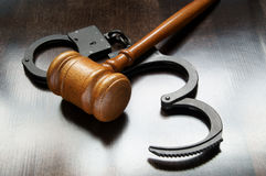 Gavel and handcuffs Stock Images