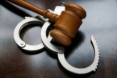Gavel and handcuffs Stock Photography