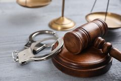 Free Gavel, Handcuffs And Scales Of Justice On Grey Wooden Table. Criminal Law Royalty Free Stock Photography - 160524287